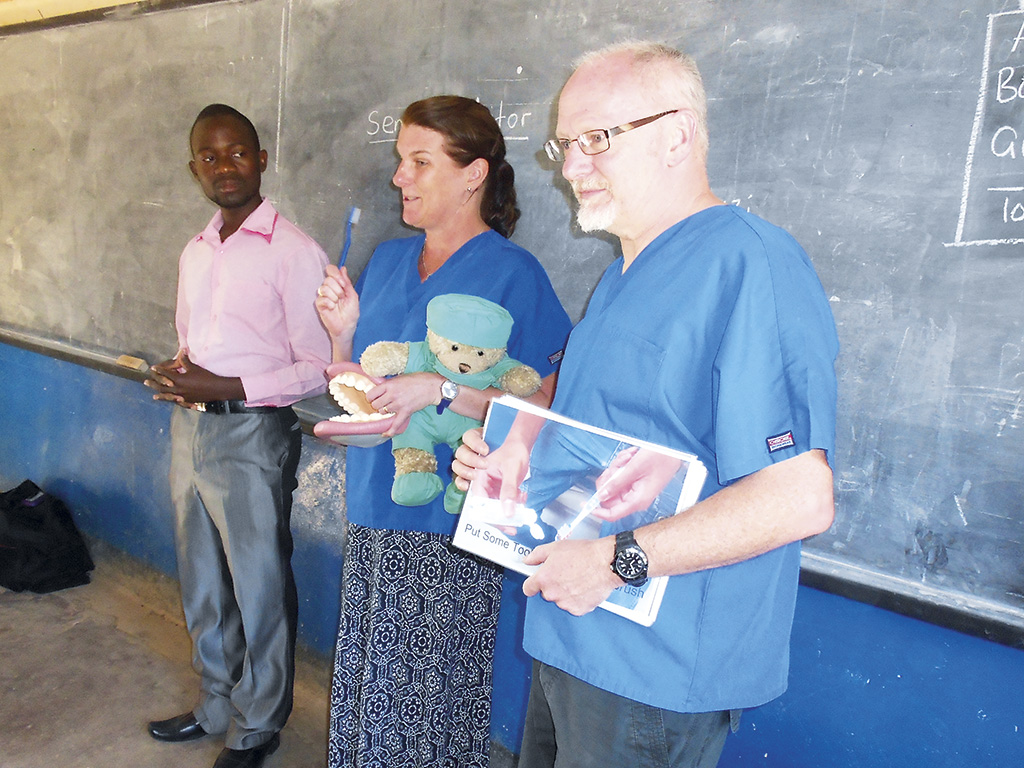 Vicky and Nigel Milne talk at a Malawian school