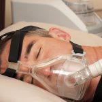 Continuous positive airway pressure (CPAP) machine in use