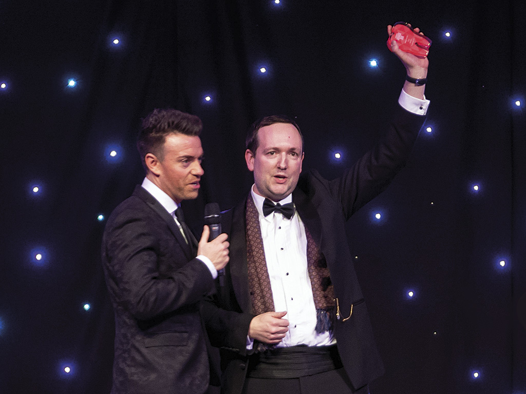 Mike Gow on stage with Des Clarke at the 2018 Scottish Dental Awards